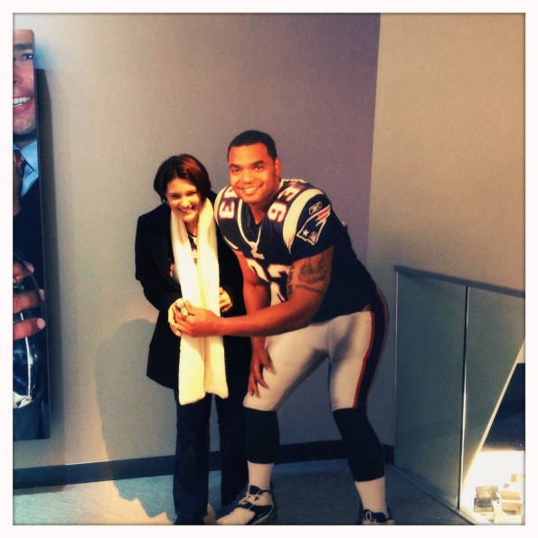 Me posing with a Richard Seymour cut-out, trying on a Super Bowl ring