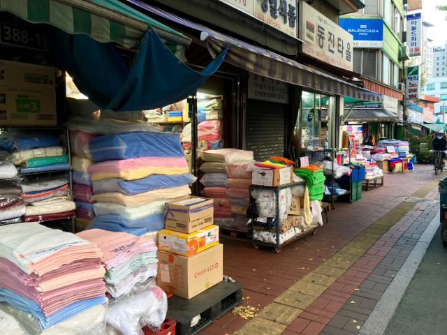 Need a towel? This street had stall after stall filled with towels for sale