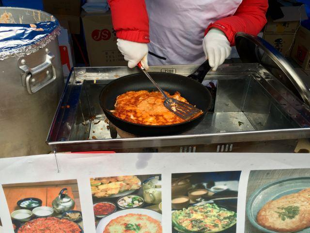 Kimchi pancake being cooked