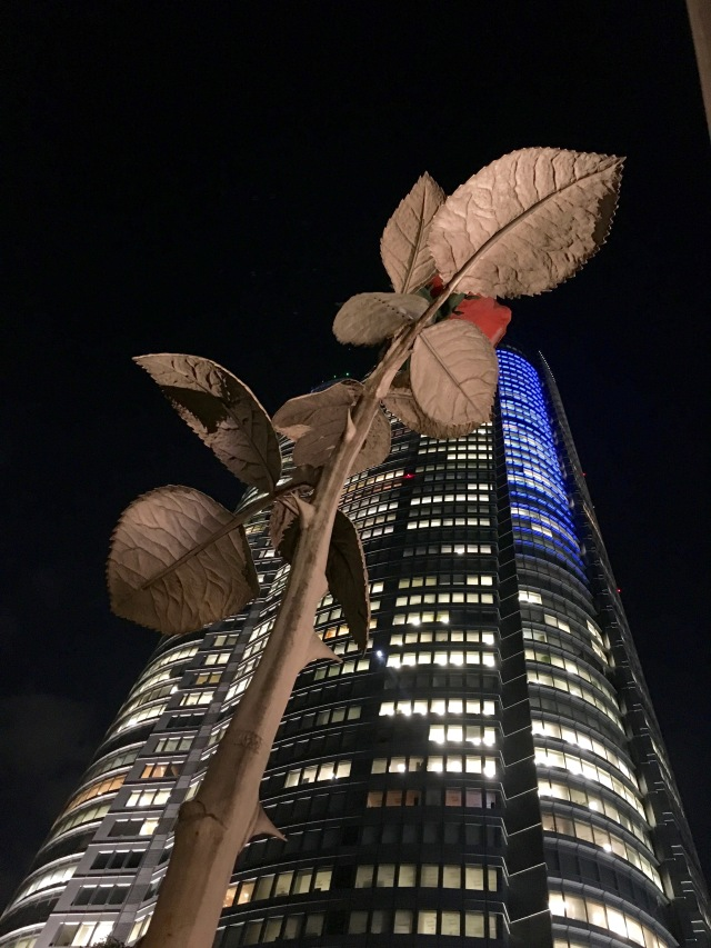 Very tall rose sculpture in front of Mori Tower