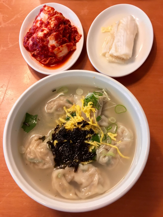 Tasty dumpling soup with some of the best kimchi I've ever had on the side.