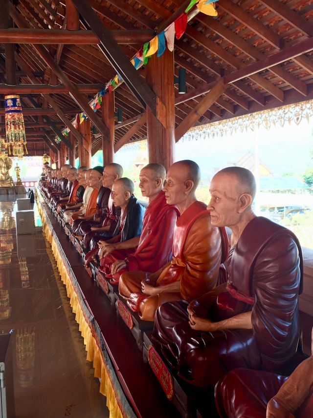 A line of monk statues based on real monks - they were eerily lifelike